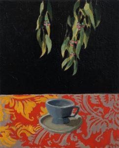 Image of painting by nils benson. Oil on canvas eucalyptus leaves dangle in darkness above a red and gold patterned area on which a tea cup has been painted.